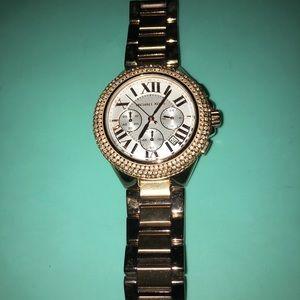 Rose gold Michael Kors watch.
